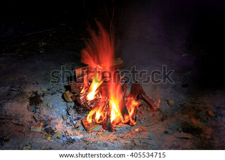 red hot flame of campfire in darkness - stock photo