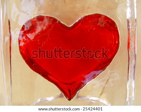 Red hot heart in cold ice back yellow - stock photo