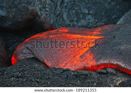 Red hot lava flow in the dark, Big Island, Hawaii  - stock photo