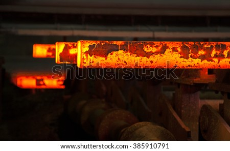 red hot slabs on steel mill conveyor - stock photo