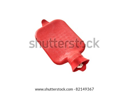 Red hot water bottle isolated on white. - stock photo