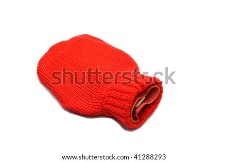 Red hot water bottle made of rubber and woven over white