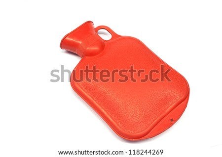 Red hot water bottle made of rubber in front of a white background - stock photo