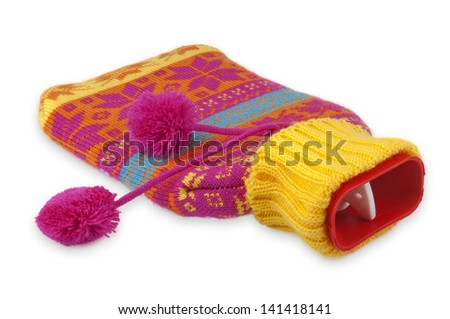 Red hot water bottle on white background. - stock photo