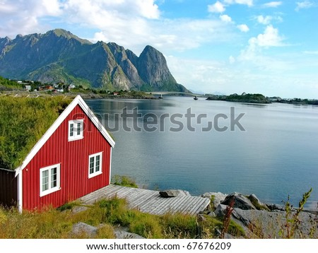 Red house by the sea in Lofoten Islands