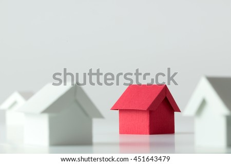 Red house in among white houses for real estate property industry