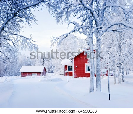 Red house in snow fairy forest. Finland - stock photo