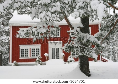 Red house in the snow - stock photo