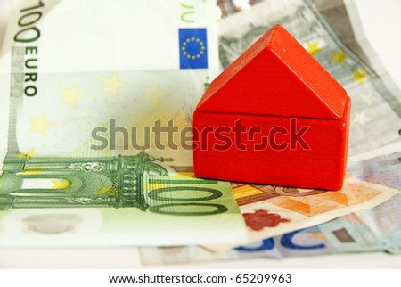 Red house on euro money, household and financing concept - stock photo