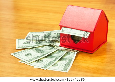 Red house on pile of money