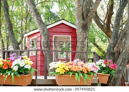 red house on tree in garden - stock photo