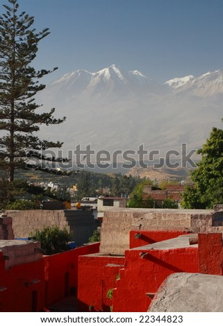 Red houses and Volcano - stock photo