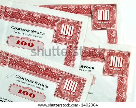Red hundred shares certificates. Red common stock certificates. Vintage beautiful decorative documents. - stock photo