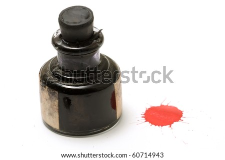 Red ink spot next to a bottle - stock photo