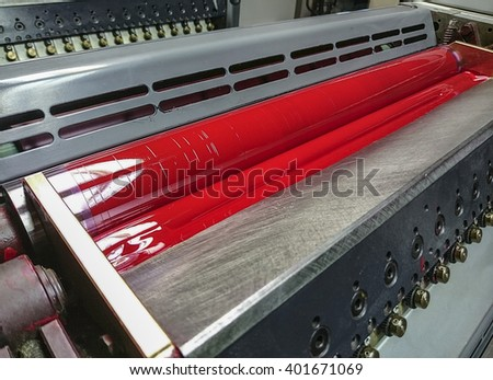 red inking unit of a sheetfed offset printing machine - stock photo