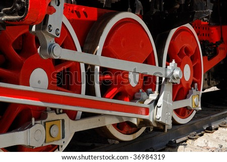 Red iron wheels of the retro steam locomotive