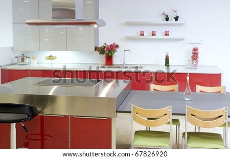 Red island kitchen silver modern interior house architecture - stock photo