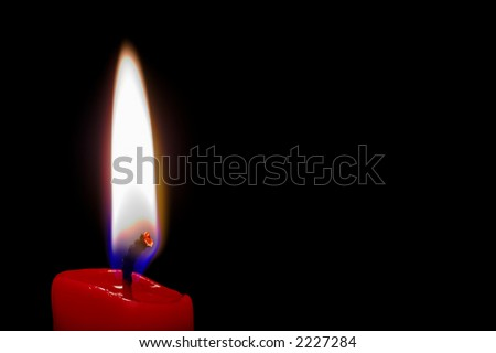 Red (isolated)  lighted candle in black background with space intentionally left blank for text. - stock photo