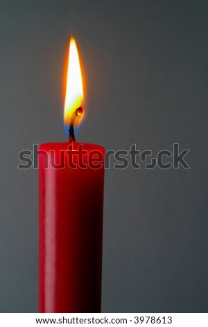 Red (isolated)  lighted candle in gray background isolated - stock photo