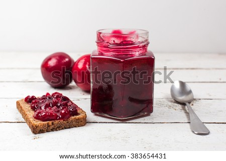red jam on the table - stock photo
