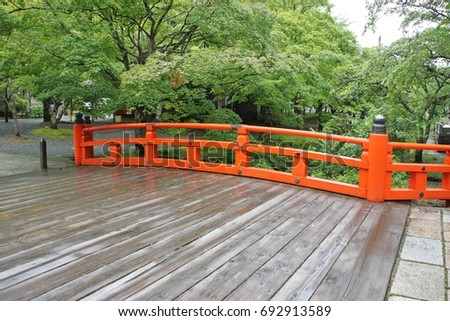 Red Japanese traditional bridge in old Okunoin Cemetery. Mount Koya, Japan