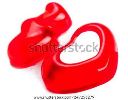 red jelly hearts in the form of three close-up on a light background