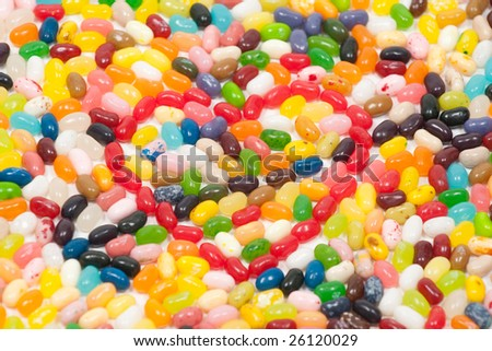 Red jellybean heart with arrow surrounded by other jellybeans