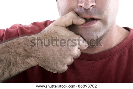 red jersey guy biting his nails a stressful situation - stock photo