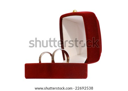 red jewelery box with two wedding rings isolated on white