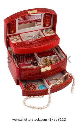 Red jewellery box with different jewelry inside - stock photo