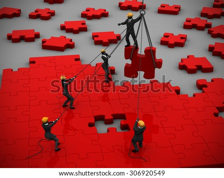 Red Jigsaw puzzle being built by teamwork. A great red jigsaw puzzle being built by a successful team. - stock photo