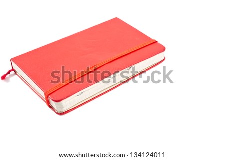 Red journal  with staples on pages over white background - stock photo