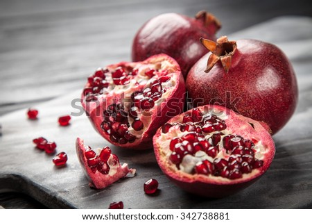 Red juice pomegranate on dark background - stock photo