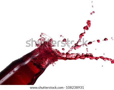 Red juice splash from a bottle - stock photo