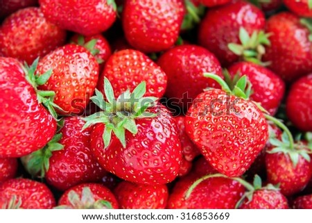 Red juicy and tasty organic strawberries backgground - stock photo