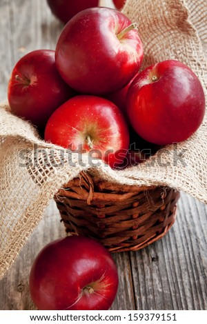 Red Juicy Apples Placed in a Basket - stock photo