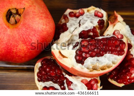 Red juicy pomegranate, whole , half, ripe and broken fruits