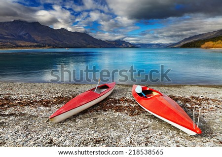 Red kayaks at the lakeside, Wakatipu Lake, New Zealand - stock photo