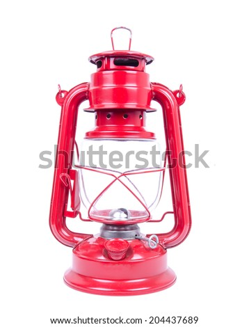 red kerosene lamp on a white background - stock photo
