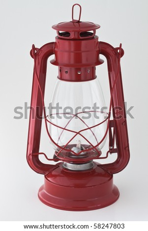 Red kerosene lantern on white background - stock photo