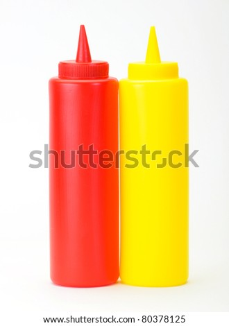 Red Ketchup and yellow mustered dispenser isolated on white background