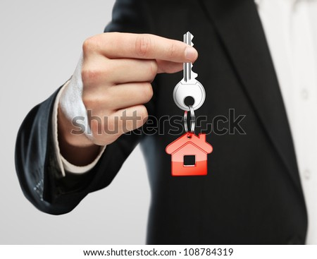 red key chain with key in hand  businessman - stock photo