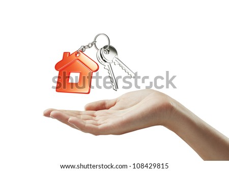 red key chain with key in hand on white background - stock photo