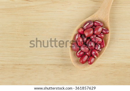 Red Kidney beans and wooden spoon, Red beans. - stock photo