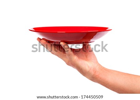 Red kitchen plate on a hand isolated on white background - stock photo