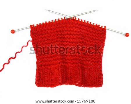 Red knitting on white background . - stock photo