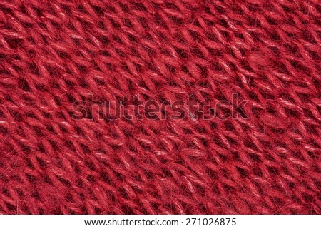 Red knitting wool texture background. - stock photo