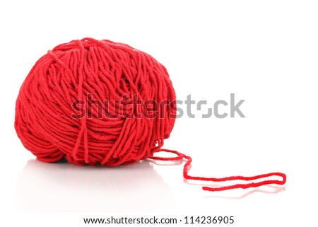 Red knitting yarn isolated on white