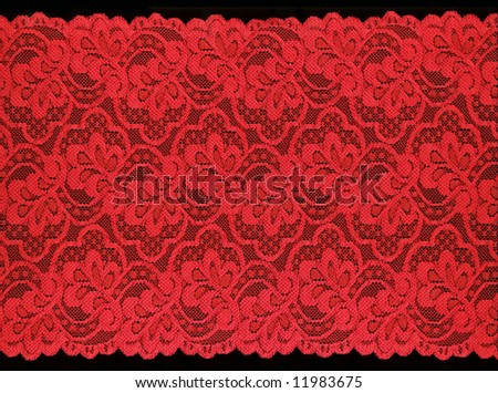 red  lace on black background - stock photo