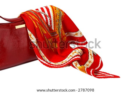 Red ladies' handbag and scarf isolated on white with path